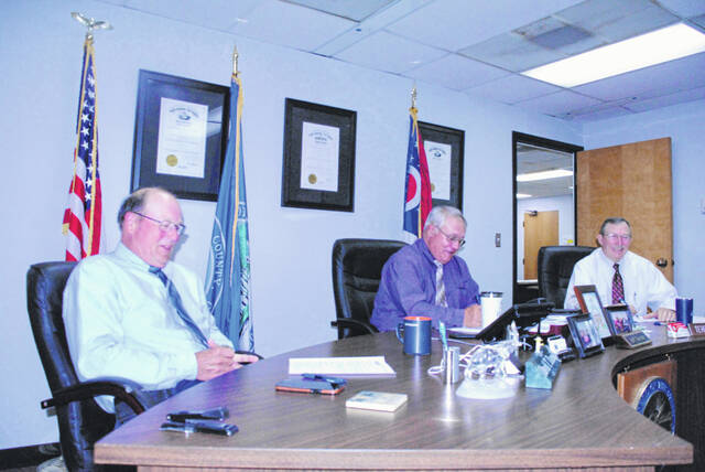 Highland County commissioners (l-r) David Daniels, Jeff Duncan and Terry Britton are pictured during their weekly Wednesday meeting.