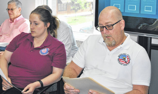 Tim Hazelwood (right) is pictured at Thursday's Highland County Board of Commissioners meeting.