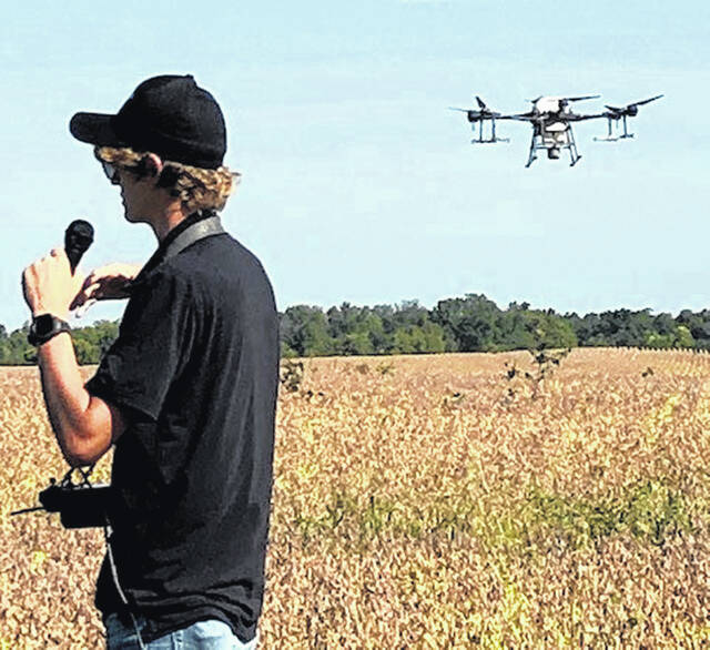 Midwest Air demonstrates spraying and cover crop seeding with a drone.