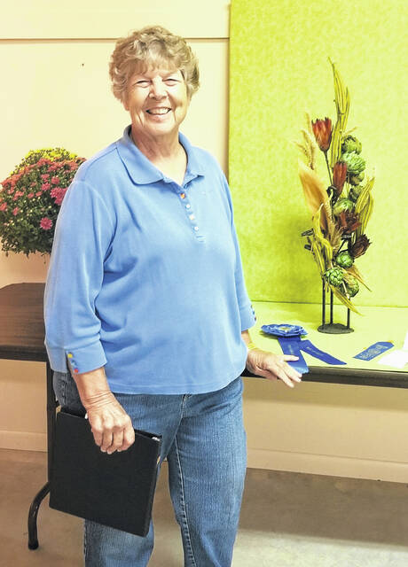 Floral Design Best of Show winner Carol Gorby is pictured with her victory garden of dried vegetables at the 2021 Highland County Fair..