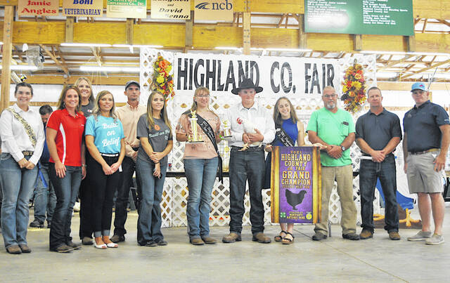 J.C. Ogden's Grand Champion Poultry Meat Pen sold for $2,800 Thursday at the Highland County Fair. Ogden is pictured with the buyers, whose names were not available at press time. The buyers will be named in The Times-Gazette's upcoming Fair Memories publication.