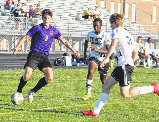 McClain's Andrew Newland (9) scored both goals for the Tigers last week in a 4-2 Frontier Athletic Conference loss to Miami Trace at McClain Field. Also pictured are Miami Trace's Nfanly Mara (77) and Todd Ford (31).