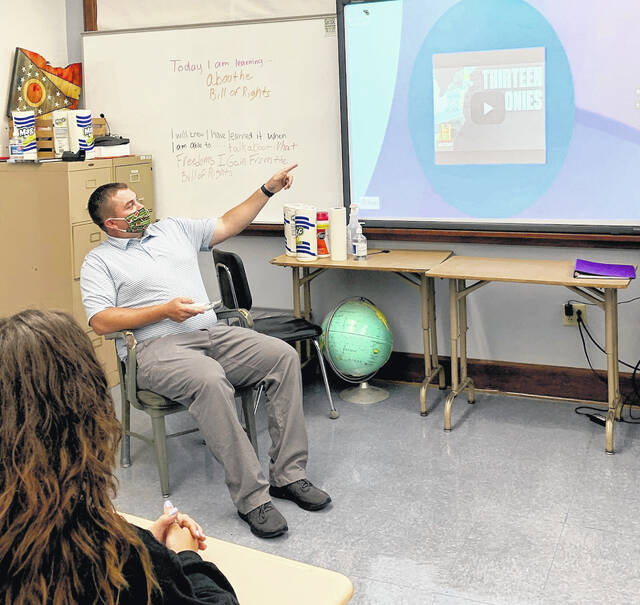 Ethan Hurtt is pictured teaching at McClain High School.