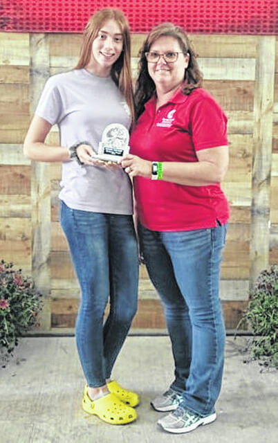 During the Junior Fair Award Ceremony held on Monday during the Highland County Fair, Catherine Knope (left) received the Outstanding Junior Leader Award. The award is given to the Junior Leader who has taken on expanded and exceeded at their leadership roles through 4-H. Catherine is the daughter of Andrew and Staci Knope. She is pictured Kathy Bruynis of the Highland County OSU Extension Office.