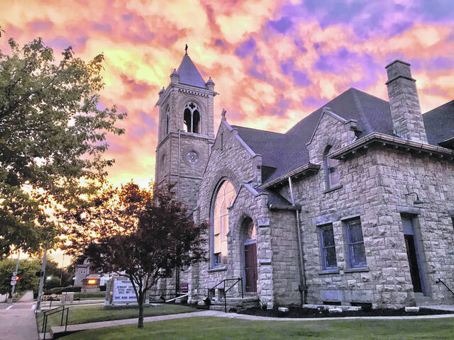 This is a picture of the First Presbyterian Church on Jefferson Street in Greenfield at sunset.