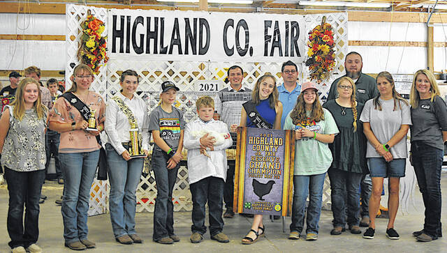Jude Pfeiffer's Reserve Grand Champion Poultry Meat Pen sold for $900 Thursday at the Highland County Fair. Pfeiffer is pictured with the buyers, whose names were not available at press time. The buyers will be named in The Times-Gazette's upcoming Fair Memories publication.