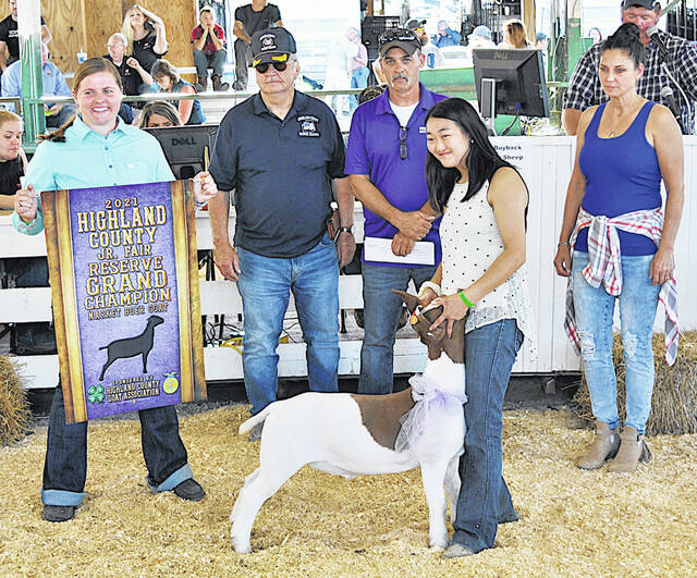 Sophie Young's Reserve Grand Champion Market Boer Goat was exhibited sold for $5 per pound Friday at the Highland County Fair. It was purchased by Rock Cliff Acres, Service Master and VFW Post 9094.