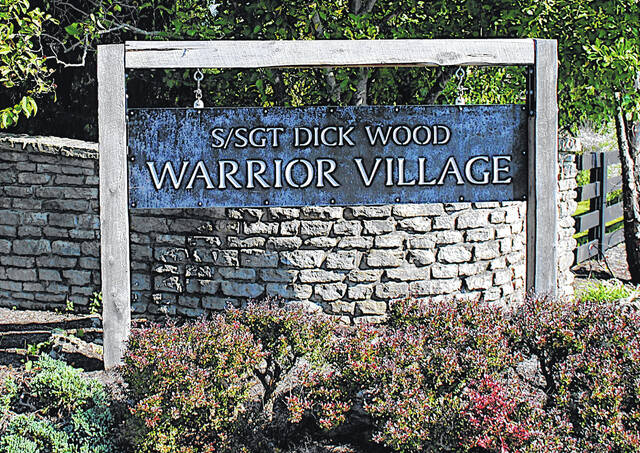 This sign sits at the entrance to Warrior Village, southwest of Hillsboro on S.R. 138.
