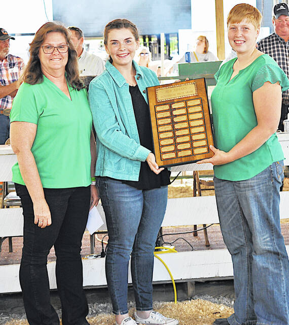 Sara Newsome (center) the 2021 Bob Shanks Award winner, is pictured with 2020 winner Lana Grover (left) and Kathy Bruynis.