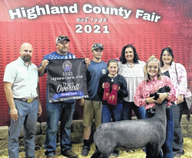 Pictured above is Jessie Saterfield with her third overall lamb.