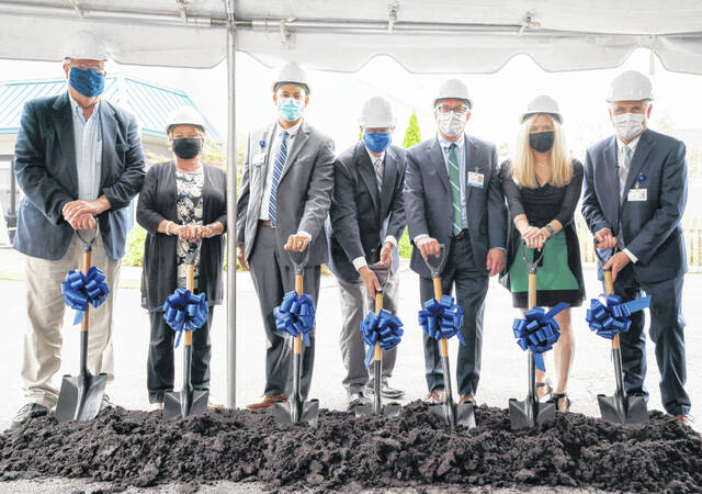 Adena Health System representatives break ground Thursday on a $3 million project to expand the Greenfield Adena Medical Center.