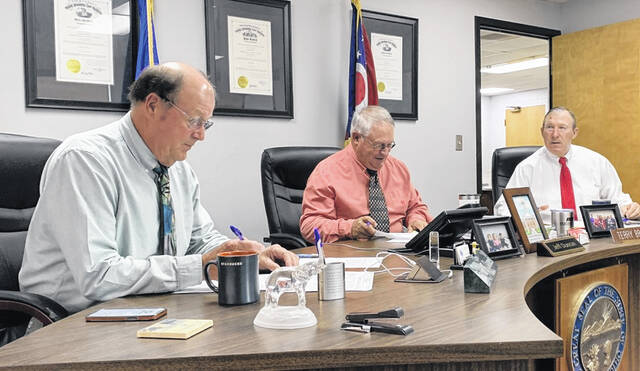 The Highland County commissioners (l-r) David Daniels, Jeff Duncan and Terry Britton, are pictured during their weekly Wednesday meeting.