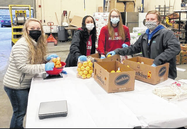 Pictured sorting fruit in 2020 are Hillsboro FFA members (l-r) Halle Reveal, Morgan Garmen, Reagen Eastes and Riley Collins.