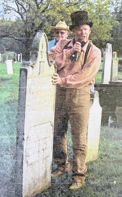 Scott Anderson portrays a person that made headstones during the Greenfield Historical Society's Ghost Walk in 2017.