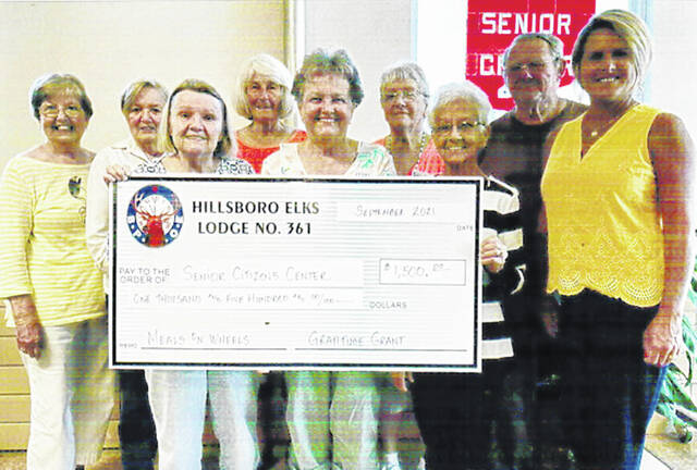 Hillsboro Elks Lodge 361 recently donated $1,500 to the Highland County Senior Citizens Center for its Meals on Wheels program. The fallout of the COVID-19 pandemic is far reaching and has been especially taxing on the elderly. The Hillsboro Elks hope to help ensure the Meals of Wheels program continues. The Elks donation is part of the Gratitude Grant that it was awarded through the Elks National Foundation. Pictured are senior center members with Hillsboro Elks Grant Coordinator Laura Bagshaw.