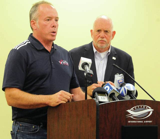 Michael Emhoff, Chairman of the United States Air & Trade Show, left, and Terry Slaybaugh, Director of Aviation for the City of Dayton, address the media at Dayton International Airport on Friday afternoon following an incident in which an F-16 Fighting Falcon aircraft belonging to the United States Air Force Thunderbirds flipped over with two persons on board.