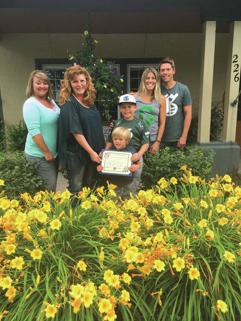 Sherri Jones and Angela Beumer, Ladybug Garden Club Community Beautification committee members, along with Grady, Gibson, Mindy, and Matt Steyer.