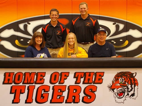 Versailles graduate Jenna Frantz committed to the University of Akron track and field team on Thursday. Pictured are (front row, l-r) mother Sonya Frantz, Jenna Frantz, father Don Frantz, (back row, l-r) Versailles track and field coach Mike Goubeaux and Versailles pole vault coach Adam Schwartz.
