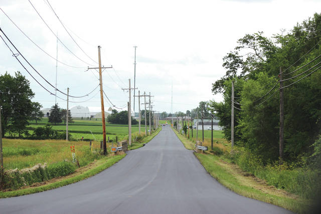A $2 million joint project between Darke County and 10 county townships will see a number of county and township roads resurfaced between July and September. Shown is recently resurfaced Meeker Road, south of Greenville.