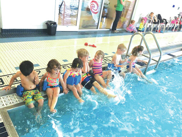 """Little swimmers at the Versailles YMCA splash water. The Versailles and Greenville branches of the YMCA completed another successful """"Safety Around Water"""" program, which saw 300 participants."""