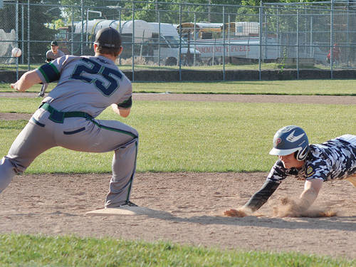 Piqua Post 184's Will Eversole dives back into first base.