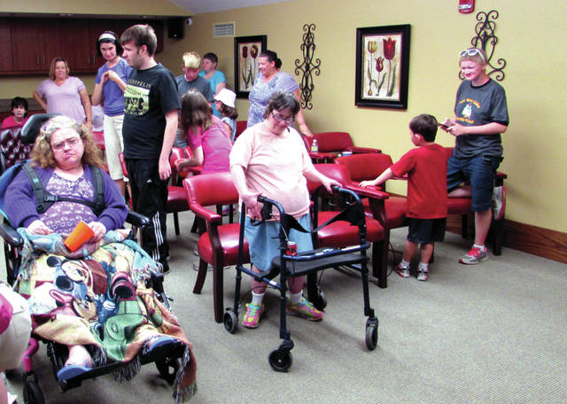 "Greenville Public Library's third floor meeting room was packed with movie fans June 23. The free event, featuring ""Charlotte's Web"" attracted a big crowd feasting on popcorn, candy bars and soda pop."