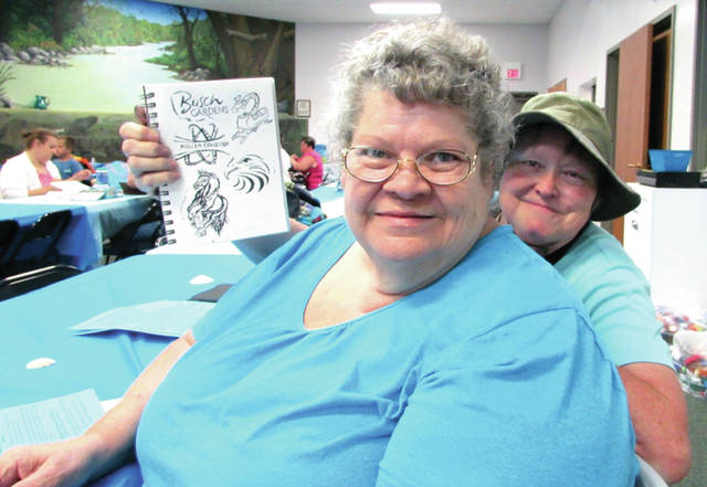 Sherry Alford (back) and Connie Myers, of Tarpon Springs Florida, drove 850 miles to attend the Letterboxing Event, in Greenville, June 17. They have been letterboxing for about 10 years.