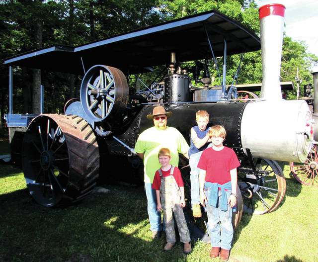 The 61st Annual Reunion of the Darke County Steam Threshers Association, Inc., took place June 29 - July 2. Pictured from left (back row): Casey Besecker, his son Troy (front row) cousin Carson and Casey's son Cole in front of Kim's 1925 23- 90 Baker. Kim is Casey's dad.