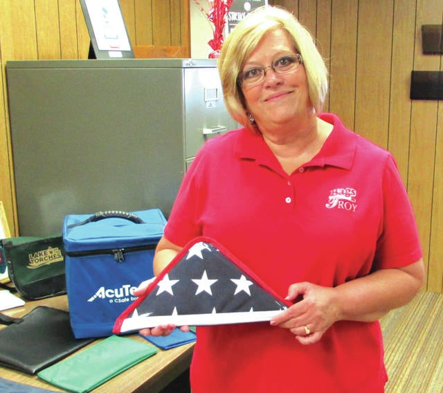 """According to Troy Sunshade Company's President and General Manager Kimberly Longfellow (pictured), the company made small flag bags for victims of the Pentagon. """"Every family got one,"""" she said. Now certain real-estate companies purchase them to give to new home owners."""