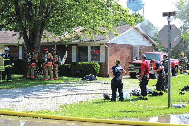Firefighters and EMT's responded to a residential fire in Ansonia Monday. One firefighter was treated then released after the ceiling of the residence collapsed.