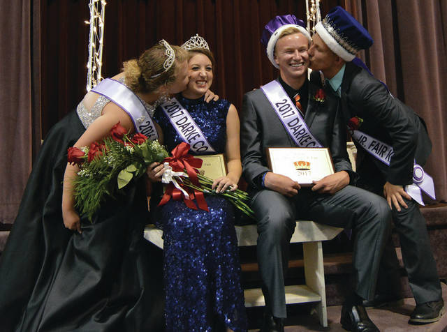 Outgoing 2016 Junior Fair Queen Molly Hunt (far left) and Isaac Gehret (far right) were the night's presenters for the 2017 Darke County Junior Fair King and Queen Pageant Tuesday evening, in Greenville. Here they are shown welcoming the new Junior Fair Queen Shelby Manning (second left) and Junior Fair King Wyatt King.