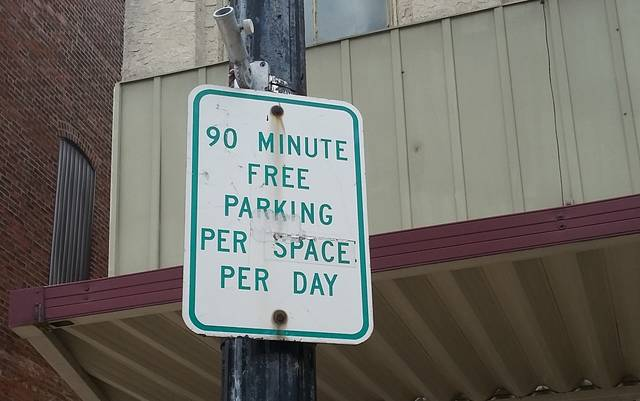 Parking sign posted downtown.