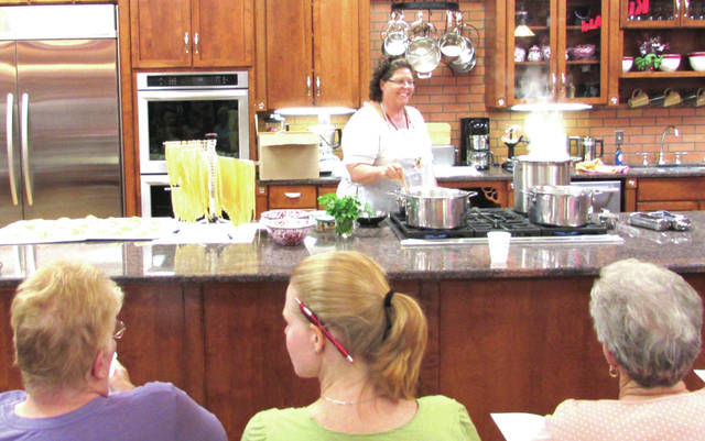 KitchenAid Store Manager Gloria Keller-Brinley was surrounded by piles of homemade pasta and boiling water in the Greenville store, Wednesday, July 12. She taught a cooking class on basic egg noodle pasta and fettuccine alfredo for the Darke County Farm Bureau.