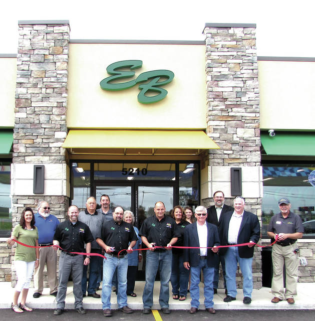 A ribbon - cutting took place at the Erwin Bros. (EB) Fuel Stop, located at State Route 49 and U.S. Route 127, in Greenville, Ohio, Saturday, July 15. Pictured are front row, left to right:EB Fuel Stop Dispatcher Barb High, Store Manager Don Beisner, Store owners Marc Erwin and Mike Erwin, Darke County Commission Chairman Michael W. Rhoades and Commission Vice-Chair Mike Stegall and Ohio Corn and Wheat Growers Association Market Development Director Brad Moffitt. Pictured in the back row, left to right: E-85 Marketing Manager at The Andersons, Inc., in Greenville, John DiMartini; Ken Erwin; Operations Manager at Erwin Bros. Trucking Mike East; Marilyn Erwin; Laurie Erwin; Sophia Aultman and her dad Darke County Commissioner Matt Aultman.