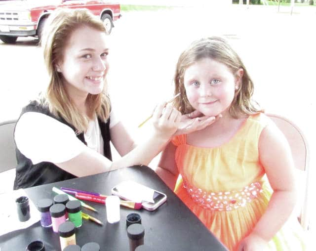 """A """"Food Truck Rally In The Park"""" took place Sunday, July 23, in the Greenville City Park. Pictured are face painter Mallory Riddle (left) painting a unicorn on the face of Lovey Crowell."""