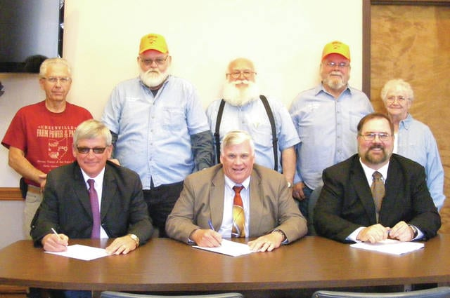 On hand for the proclamation signing at the Darke County Commissioners' office for Farm Power of the Past were, seated from left to right, Commissioners Mike Rhoades, Mike Stegall and Matt Aultman, and back row from left to right, Farm Power of the Past personnel, Larry Fox, Duane Edwards, Von Oswalt and Bill and Barb Young.