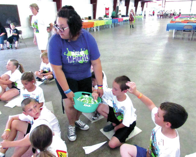 """""""We Are the Majority"""" member Zoe Harter, of New Weston, stressed to kids the importance of knowing what something is before eating, at the Darke County Chapter of Farm Safety for Just Kids annual Progressive AG Safety Day Tuesday. """"Is it medicine or candy?"""" she asked. """"Sometimes they look the same."""""""