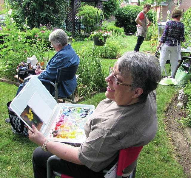 """An annual Greenville Art Guild event a """"Paint Out"""" at Isabel Culbertson's home in Greenville, brought about 15 artists, Thursday, June 29, including local art teacher Sandy Cable - Barringer."""