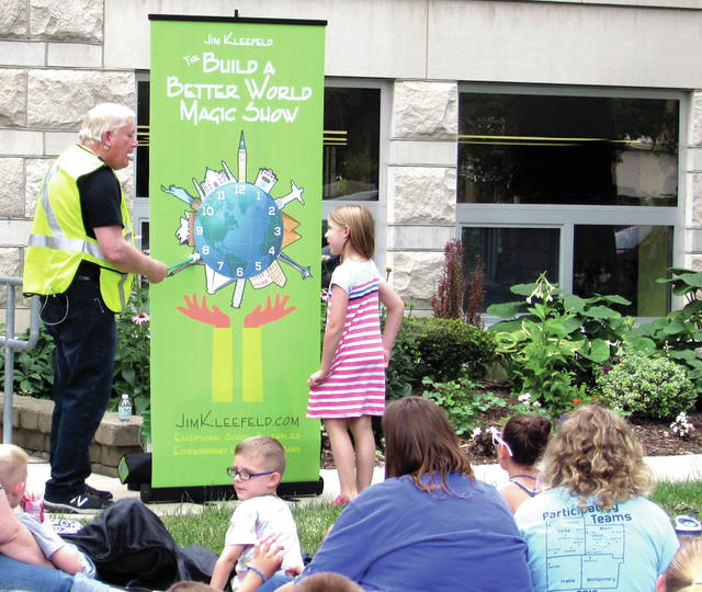 """Greenville Public Library """"Family Fun Days"""" series through the its """"Build a Better World"""" 2017 Summer Reading Program featured """"The Build a Better World Magic Show"""", July 5. Magician Jim Kleefeld is pictured with his assistant from the crowd Marion Winterrowd."""