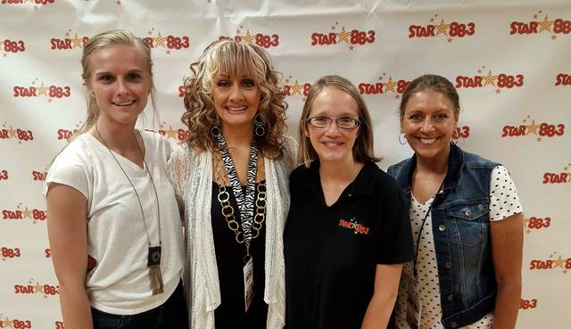 STAR 88.3 staff at the 2-year celebration Tuesday. From left, Kinsey Williams, Melissa Montana, Naomi Cantrell, and Beth Berry.