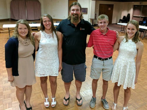 The Light Foundation awarded $1,000 scholarships to four Darke County students. Pictured (l-r) are Greenville's Molly Hunt, Mississinawa Valley's Madison Stachler, Matt Light, Tippecanoe's Keenan Fraylick and Versailles' Kara Langenkamp.
