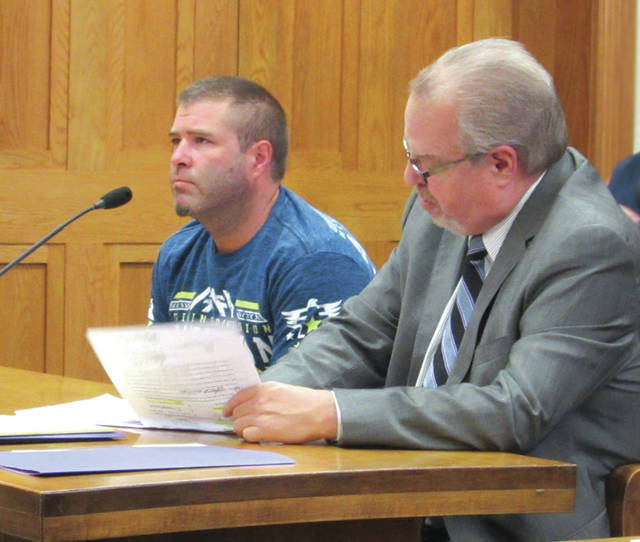 David L. Stephens (left, with attorney Dave Rohrer) was one of seven people arraigned Monday in Darke County Common Pleas Court. Stephens pleaded not guilty to two felony counts and three misdemeanor charges.