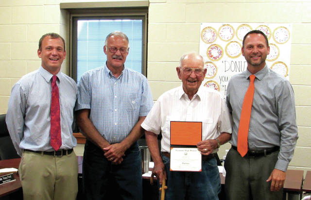 Arcanum-Butler Local School District Board of Education approved that Howard Eley, of Arcanum, receive his high school diploma. They awarded his diploma Thursday, August 10. Pictured from left to right: High School Principal Jason Stephan; Arcanum-Butler School Board President Ed Everman; 1939 Graduating Class Diploma recipient and WWII Veteran Howard Eley, of Arcanum and Superintendent John Stephens.