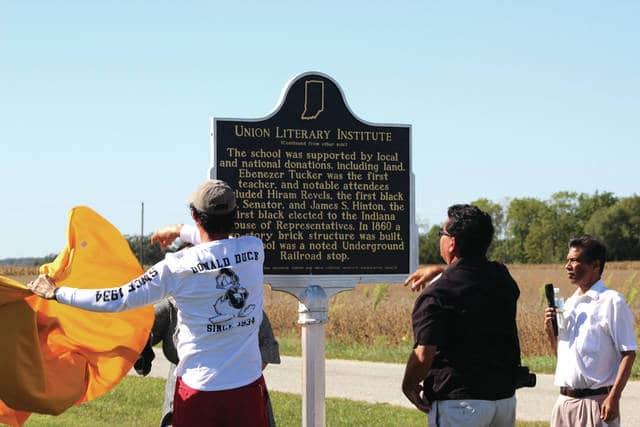 Roane Smothers (far right), president of the Union Literary Institute Preservation Society, watches as attendees unveil the marker commemorating the school's place in local history.