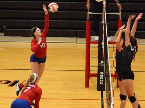 Tri-Village's Autaum Moore goes up for a kill during a volleyball match against Preble Shawnee on Monday in Camden.