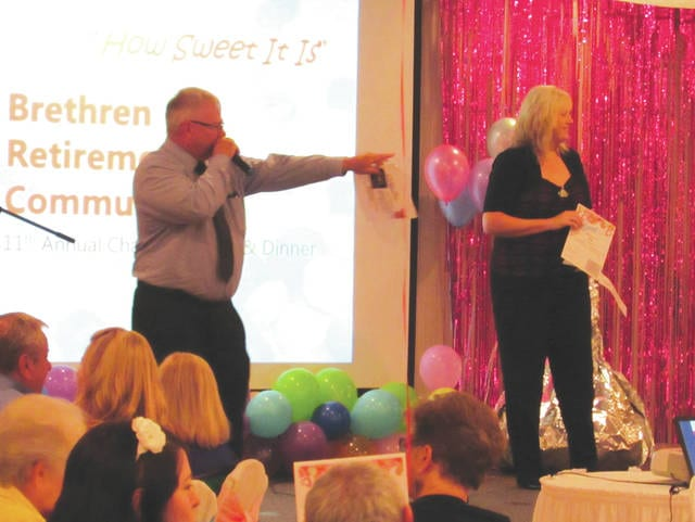 Rich Edwards served as auctioneer and Nancy Wilson of K99.1 FM served as MC during the Brethren Retirement Community's 11th annual charity auction and dinner held Friday at Romer's Catering in Greenville.