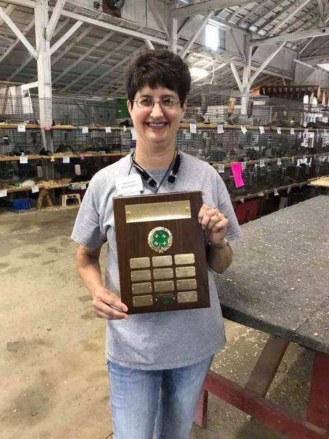 Courtesy photo Pat Carroll of Greenville and advisor of Show Hopper 4-H club was the recipient of the 2017 Darke County Junior Fair Family Rabbitry Award, the Rabbit Barn's version of a distinguished service award.