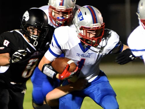 Tri-Village's Christian Ricker carries the ball during a Cross County Conference football game against Mississinawa Valley on Friday in Union City.