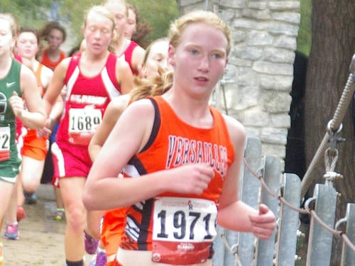 Versailles' Emma Peters runs during the Treaty City Invitational cross country meet on Sept. 2 in Greenville.