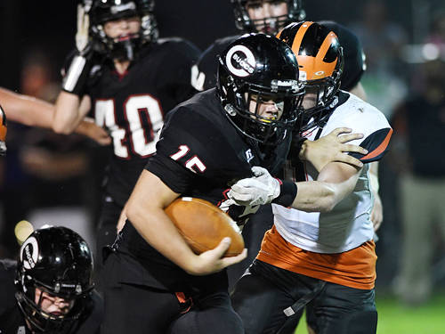 An Arcanum defender tries to tackle Covington's Gage Kerrigan during a Cross County Conference football game on Friday in Covington.